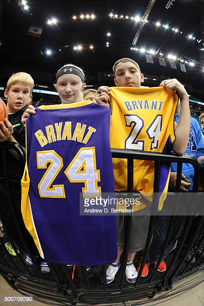 Fans hold Kobe Bryant of the Los Angeles Lakers jersey before the game against the Minnesota Timberwolves on December 9 2015 at Target Center in...