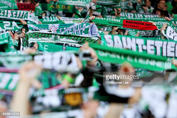 Fans hold scarves aloft as they show their support before the UEFA Europa League Round of 32 second leg match between AS SaintEtienne and Manchester...