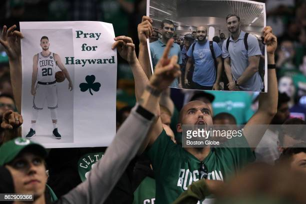 Fans hold signs in support of Boston Celtics forward Gordon Hayward who was injured the previous night during the team's seasonopening game in...