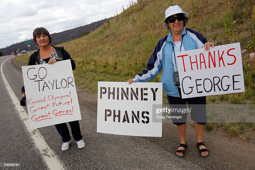 Fans hold signs in support of riders Taylor Phinney and George Hincapie during stage one of the USA Pro Challenge from Durango to Telluride on August 20, 2012 in Durango, Colorado.