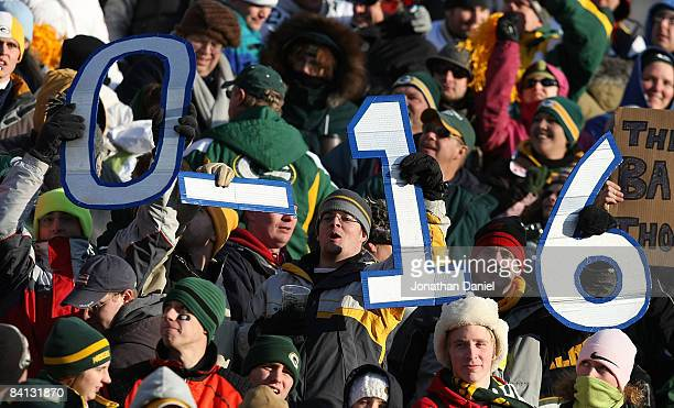 Fans hold signs indicating the impending record of the Detroit Lions during a game between the Lions and the Green Bay Packers on December 28 2008 at...