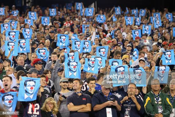 Fans hold towels depicting NFL Commissioner Roger Goodell wearing a clown nose during the game between the Kansas City Chiefs and the New England...
