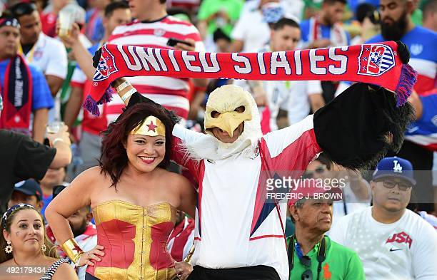 US fans hold up a banner ahead of kickoff for their 2015 CONCACAF Cup match against Mexico at the Rose Bowl in Pasadena California on October 10 a...