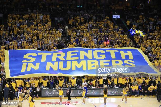 Fans hold up a banner during the second half in Game 5 of the 2017 NBA Finals between the Golden State Warriors and the Cleveland Cavaliers at ORACLE...