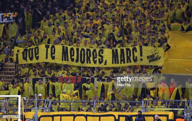 Fans hold up a banner during the UEFA Champions League Quarter Final first leg match between Borussia Dortmund and AS Monaco at Signal Iduna Park on...