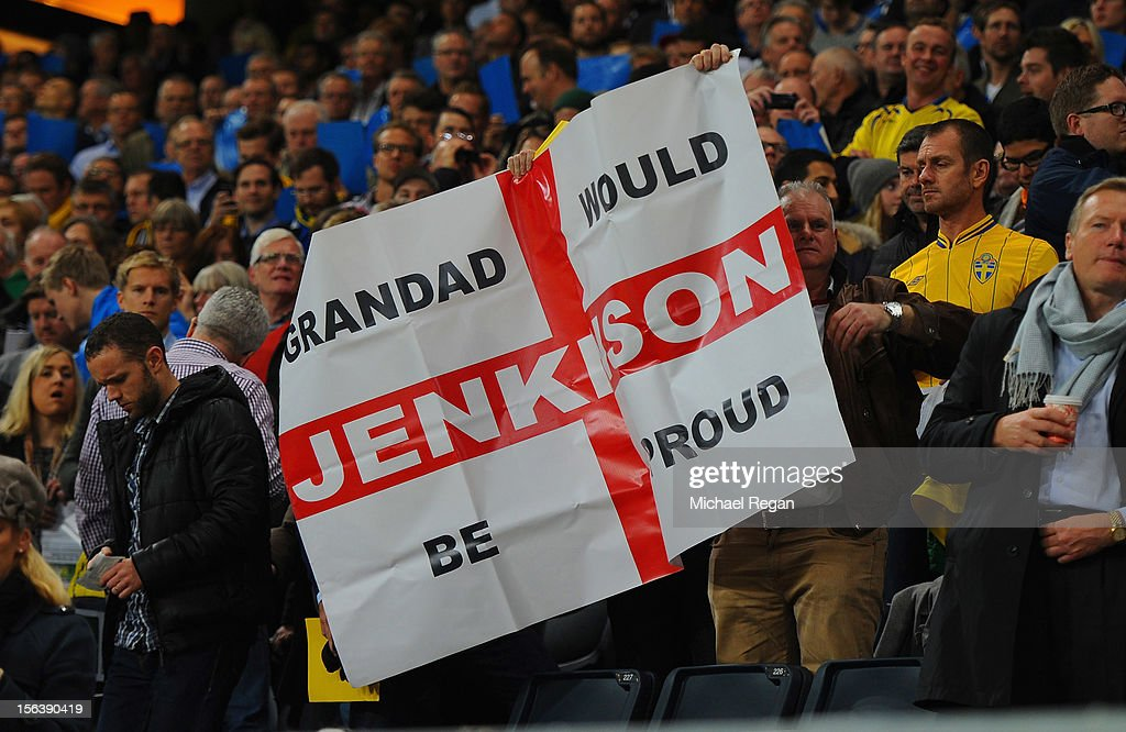 Fans hold up a banner for Carl Jenkinson during the international friendly match between Sweden and England at the Friends Arena on November 14, 2012 in Stockholm, Sweden.