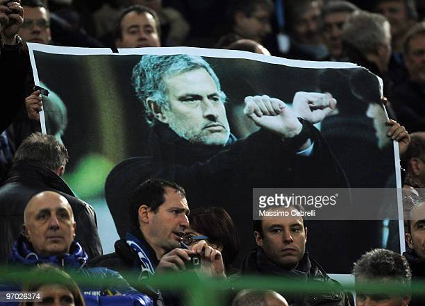 Fans hold up a banner of Inter Milan's head coach Jose Mourinho during the UEFA Champions League round of 16 first leg match between FC Inter Milan...