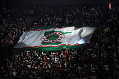 Fans hold up a flag before Game Three between the Minnesota Wild and the St Louis Blues of the Western Conference Quarterfinals during the 2015 NHL...