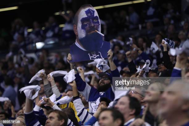 TORONTO ON APRIL 17 Fans hold up a photo of Dartman as the Toronto Maple Leafs play the Washington Capitals in game three of their NHL first round...