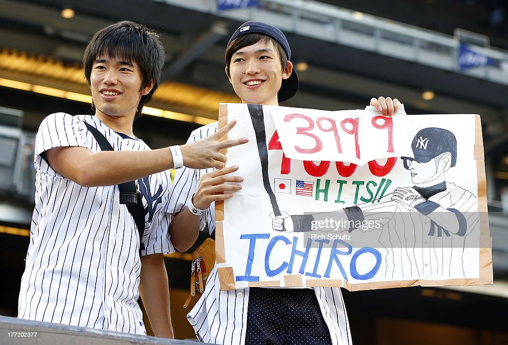 Fans hold up a sign counting the amount of hits Ichiro Suzuki #31 of the New York Yankees has before the start of a game against the Toronto Blue Jays. Ichiro singled in the first inning for his 4,000 career hit at Yankee Stadium on August 121, 2013 in the Bronx borough of New York City.