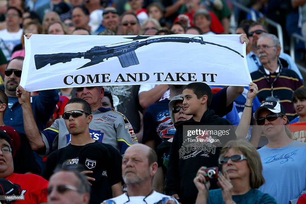 Fans hold up a sign in support of gun ownership during the NASCAR Sprint Cup Series NRA 500 at Texas Motor Speedway on April 13, 2013 in Fort Worth, Texas.
