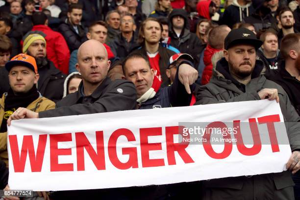 Fans hold up a Wenger Out banner in the stands during the Premier League match at The Hawthorns West Bromwich