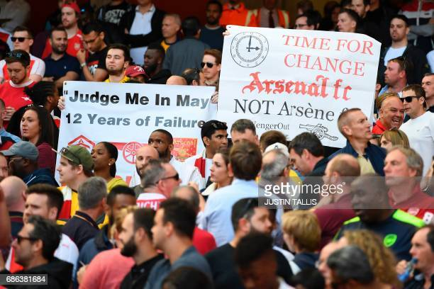 Fans hold up banners calling for a managerial change during the English Premier League football match between Arsenal and Everton at the Emirates...