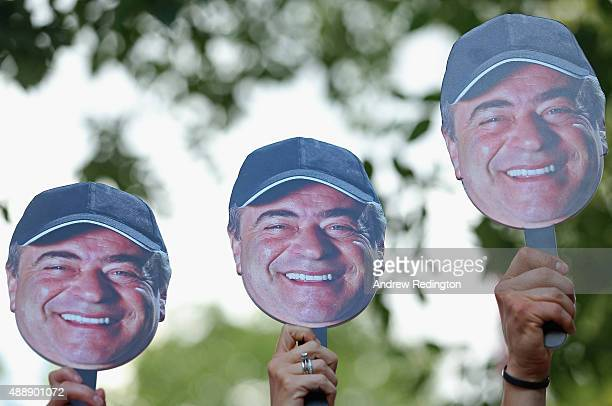 Fans hold up face signs as Costantino Rocca of Italy says goodbye to the Italian Open on the 18th green during the second round of the 72nd Open...