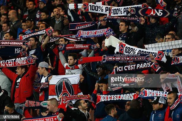 PSG fans hold up flags during the UEFA Champions League Group C match between Paris Saint Germain and RSC Anderlecht at Parc des Princes on November...