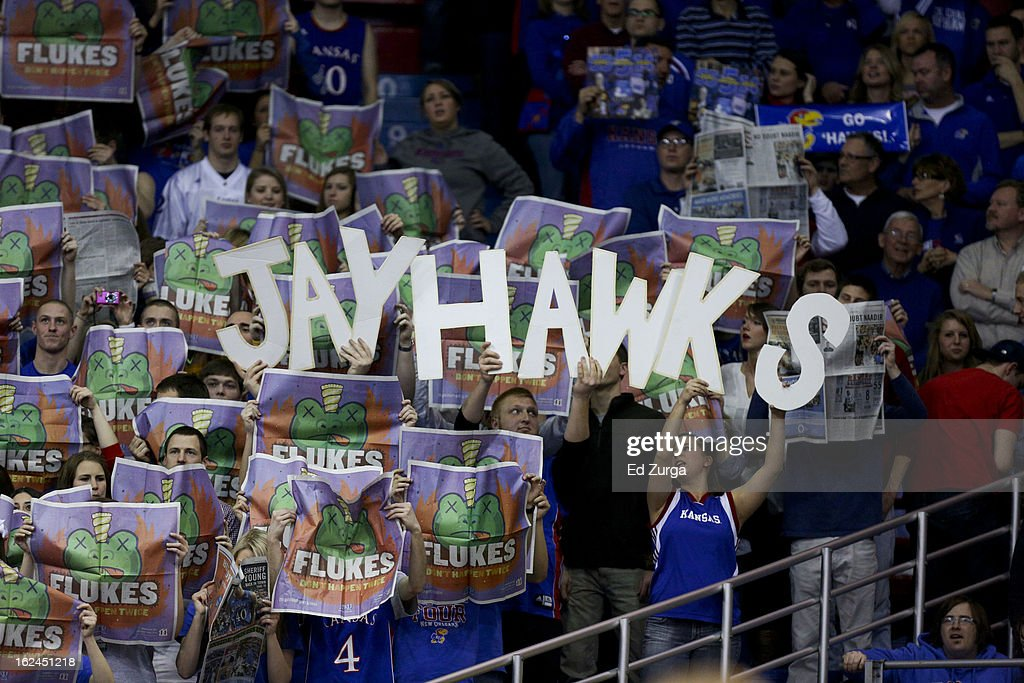 Fans hold up letters to spell out Jayhawks during a game between TCU Horned Frogs and the Kansas Jayhawks at Allen Field House on February 23, 2013 in Lawrence, Kansas.