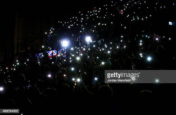 Fans hold up lights during Day Three of the Davis Cup Semi Final match between Great Britain and Australia at Emirates Arena on September 20 2015 in...