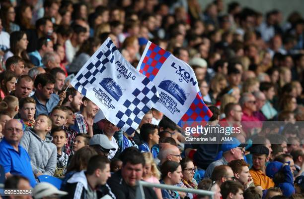 Fans hold up Lyon and PSG flags during the UEFA Women's Champions League Final match between Lyon and Paris Saint Germain at Cardiff City Stadium on...