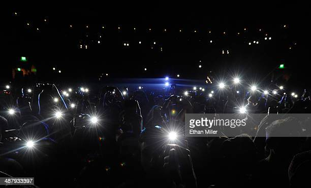 Fans hold up phones with lights as actor/comedian Donald Glover as recording artist Childish Gambino performs at The Chelsea at The Cosmopolitan of...
