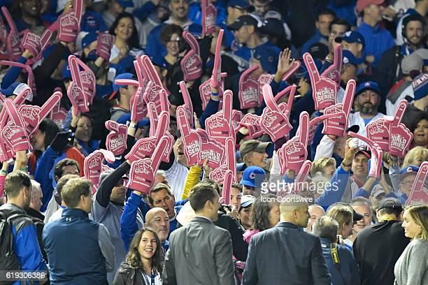 Fans hold up pink foam fingers during the 2016 World Series Game 4 between the Cleveland Indians and the Chicago Cubs on October 29 at the Wrigley...