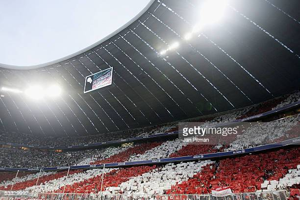 Fans hold up posters in the red and white colors of Bayern Munich before the Bundesliga match between Bayern Munich and Borussia Monchengladbach at...