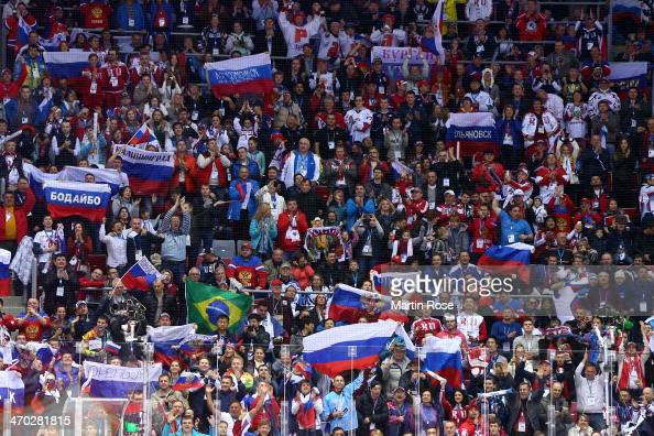 Fans hold up Russian flags during the Men's Ice Hockey Quarterfinal Playoff against Finland on Day 12 of the 2014 Sochi Winter Olympics at Bolshoy...