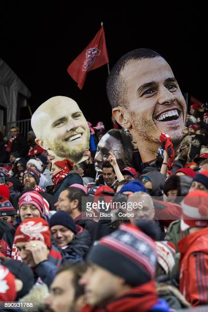 Fans hold up Sebastian Giovinco of Toronto FC and Michael Bradley of Toronto FC heads after the 2017 Audi MLS Championship Cup match between Toronto...