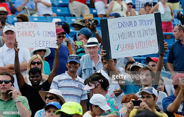 Fans hold up signs after Serena Williams defeated Simona Halep of Romania to win the womens finals of the Western Southern Open at the Linder Family...