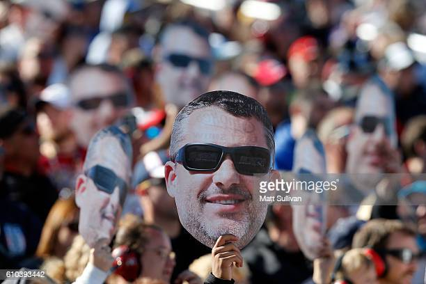 Fans hold up signs for Tony Stewart driver of the Code 3 Associates/Mobil 1 Chevrolet during the NASCAR Sprint Cup Series Bad Boy Off Road 300 at New...