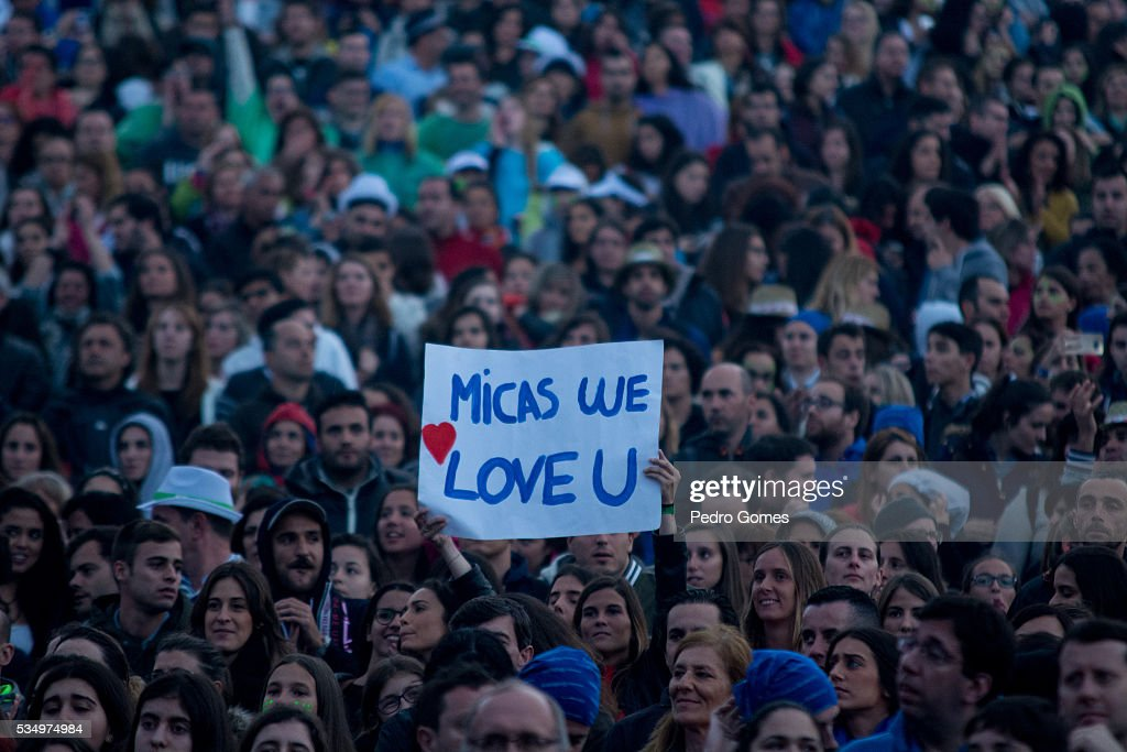 Fans hold up signs in the crowd during the performance of D.A.M.A at Rock in Rio on May 28, 2016 in Lisbon, Portugal.