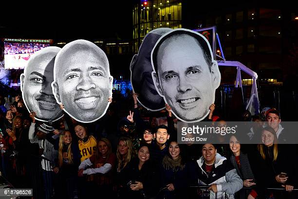 Fans hold up signs outside the arena on October 25 2016 before the New York Knicks game against the Cleveland Cavaliers at Quicken Loans Arena in...
