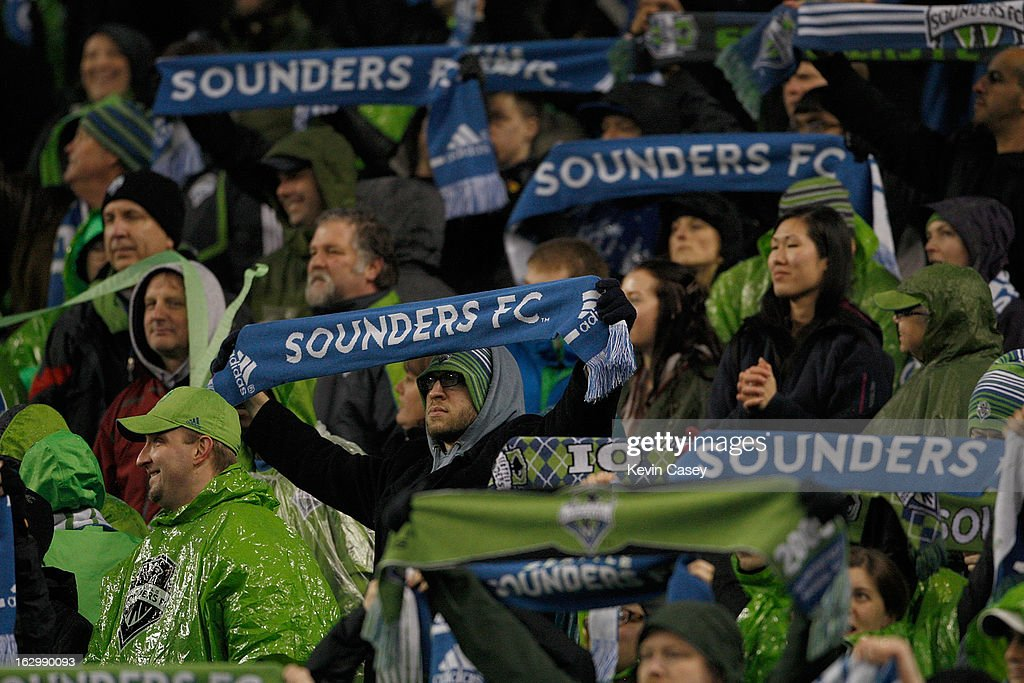 MLS fans hold up their scarves supporting the Seattle Sounders in the first half against Montreal Impact at CenturyLink Field on March 2, 2013 in Seattle, Washington.