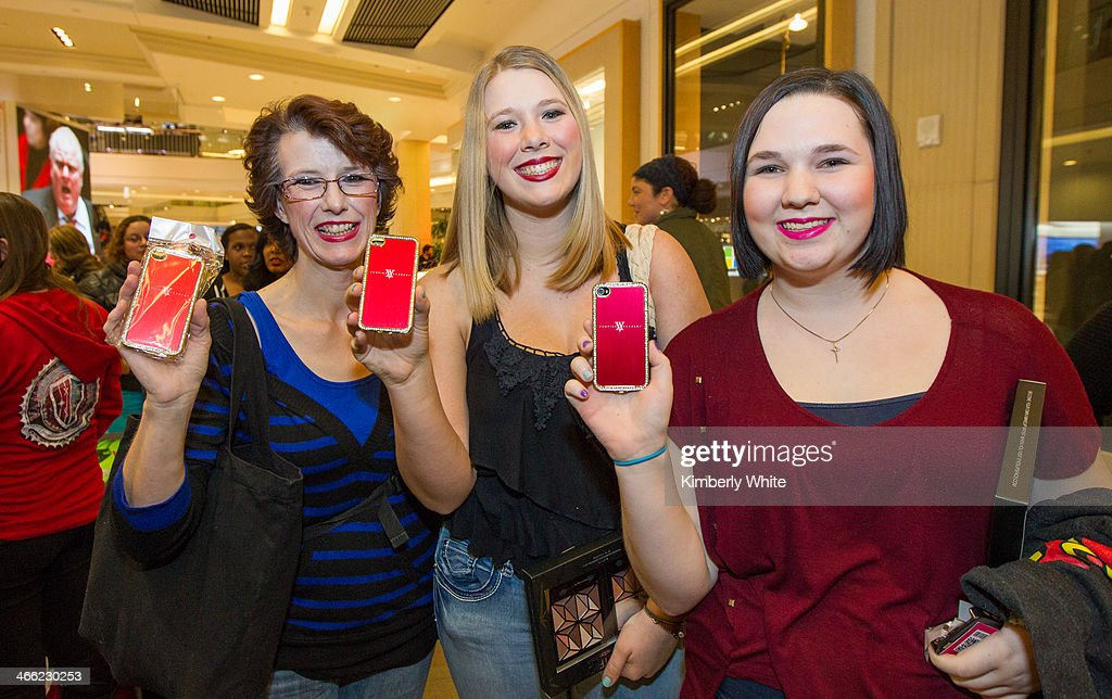 Fans hold up Vampire Academy iPhone covers at Westfield San Francisco Centre on January 31, 2014 in San Francisco, California.