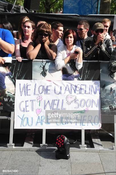 Fans holding a sign reading 'we love you Angelina get well soon you are our hero' at the World premiere of World War Z at the Empire Leicester Square...