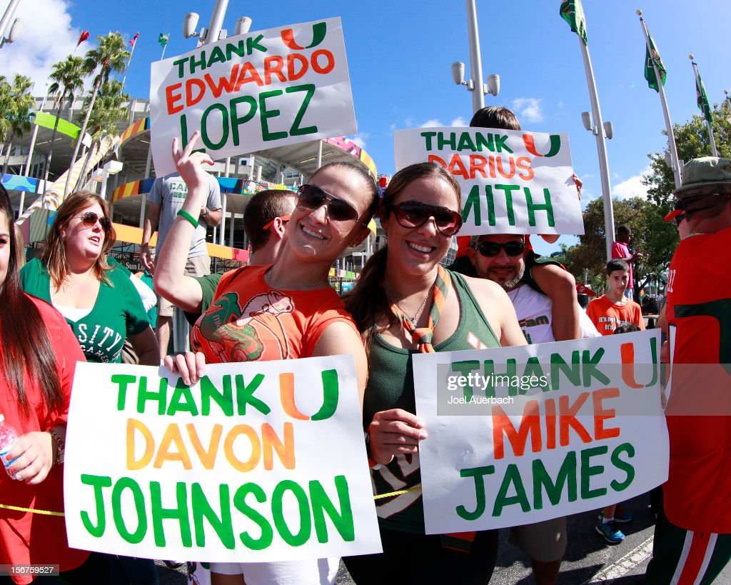 Fans holding signs thanking the Miami Hurricanes seniors prior to their arrival at the stadium for the game against the South Florida Bulls on November 17, 2012 at Sun Life Stadium in Miami Gardens, Florida.