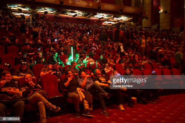 A fans holds light sabers inside the theater on opening night of Walt Disney Pictures And Lucasfilm's 'Star Wars The Force Awakens' at the TCL...
