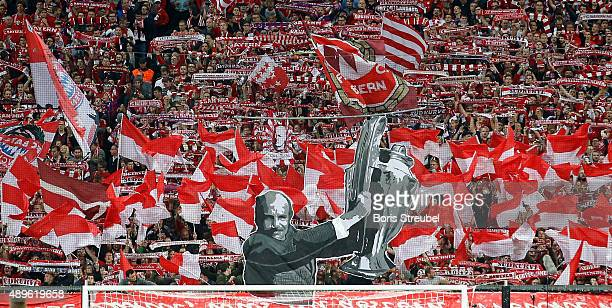 Fans honour former Muenchen coach Dettmar Cramer prior the Bundesliga match between FC Bayern Muenchen and VfL Wolfsburg at Allianz Arena on...