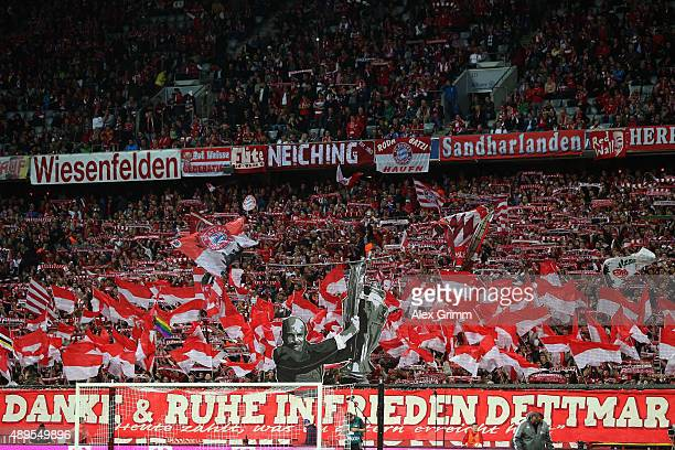 Fans honour former Muenchen coach Dettmar Cramer prior to the Bundesliga match between FC Bayern Muenchen and VfL Wolfsburg at Allianz Arena on...