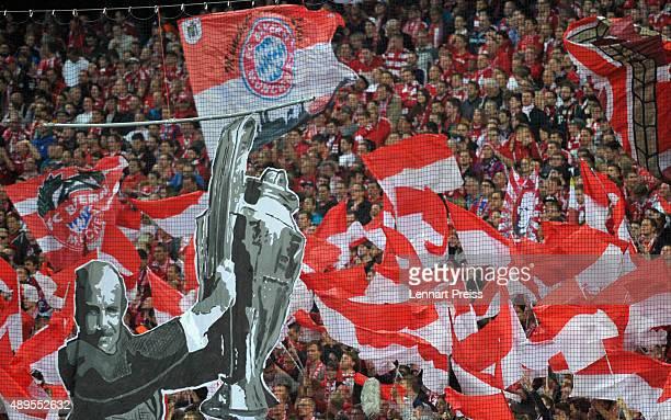 Fans honour former Muenchen coach Dettmar Cramer prior to the Bundesliga match between FC Bayern Muenchen and VfL Wolfsburg at Allianz Arena on...