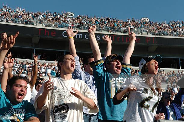 Fans in Alltel Stadium salute cheer as the Jacksonville Jaguars host the Houston Texans Nov 12 2006 in Jacksonville The Texans defeated the Jaguars...