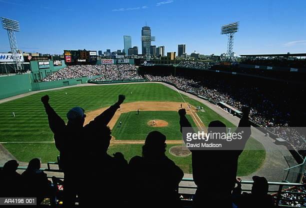 Fans in baseball stadium