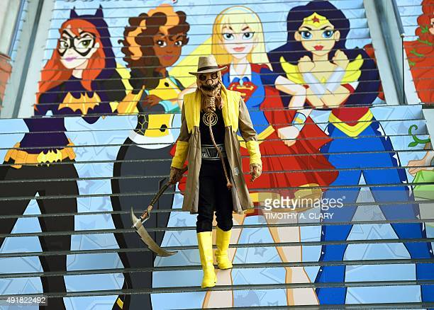 Fans in costume arrive for the opening session of the 2015 New York Comic Con at the Jacob Javits Center on October 8 2015 The fourday event which...