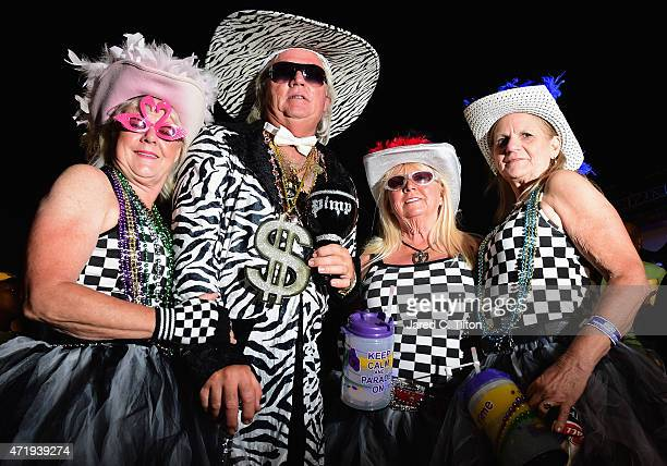 Fans in costume pose for a photo in the infield at Talladega Superspeedway on May 1 2015 in Talladega Alabama