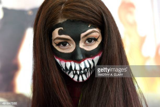 Fans in costumes arrive for the opening session of the 2015 New York Comic Con at the Jacob Javits Center on October 8 2015 The fourday event which...