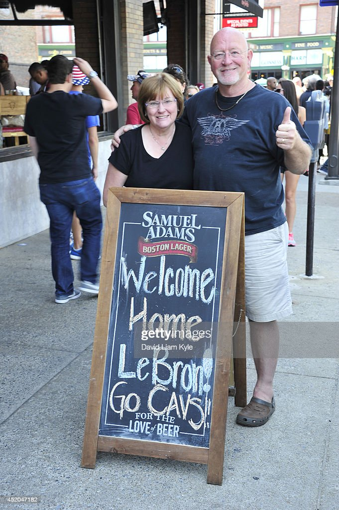 Fans in downtown Cleveland celebrate word of LeBron James returning to the Cleveland Cavaliers on July 11, 2014 in Cleveland, Ohio.