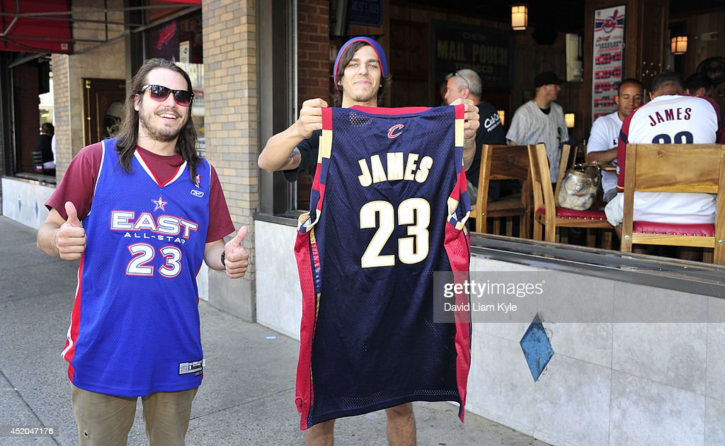 Fans in downtown Cleveland don their #23 <a gi-track='captionPersonalityLinkClicked' href=/galleries/search?phrase=LeBron+James&family=editorial&specificpeople=201474 ng-click='$event.stopPropagation()'>LeBron James</a> jerseys shortly after he announced his return to the Cleveland Cavaliers on July 11, 2014 in Cleveland, Ohio.