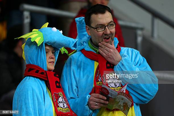 Fans in fancy dress look on from the stands before the Bundesliga match between Bayer Leverkusen and FC Bayern Muenchen at BayArena on February 6...