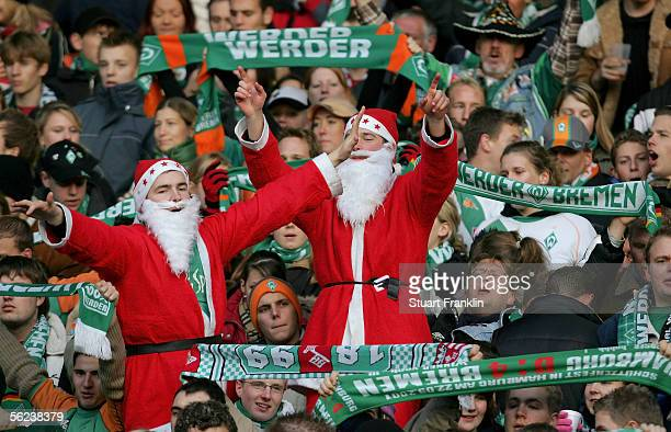 Fans in Father Christmas costumes cheer during the Bundesliga match between Werder Bremen and VFL Wolfsburg at the Weser Stadium on November 19 2005...