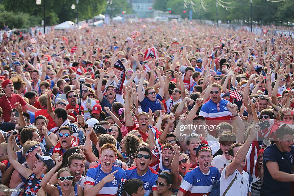 Fans in Grant Park celebrate a goal by the U.S. against Portugal in a Group G World Cup soccer match on June 22, 2014 in Chicago, Illinois. Fans were turned away from the free event after a 10,000-person capacity was reached.