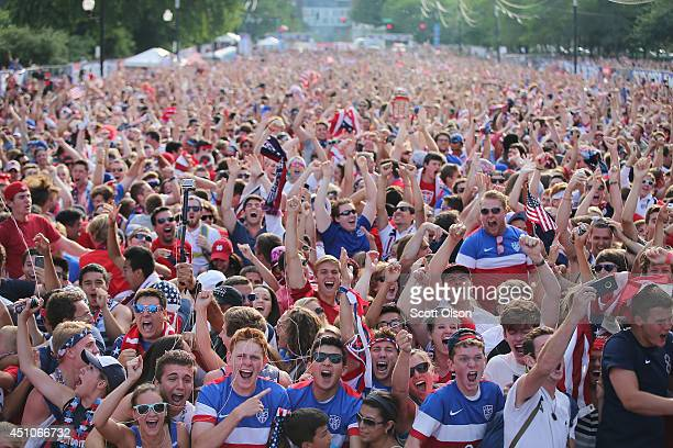 Fans in Grant Park celebrate a goal by the US against Portugal in a Group G World Cup soccer match on June 22 2014 in Chicago Illinois Fans were...
